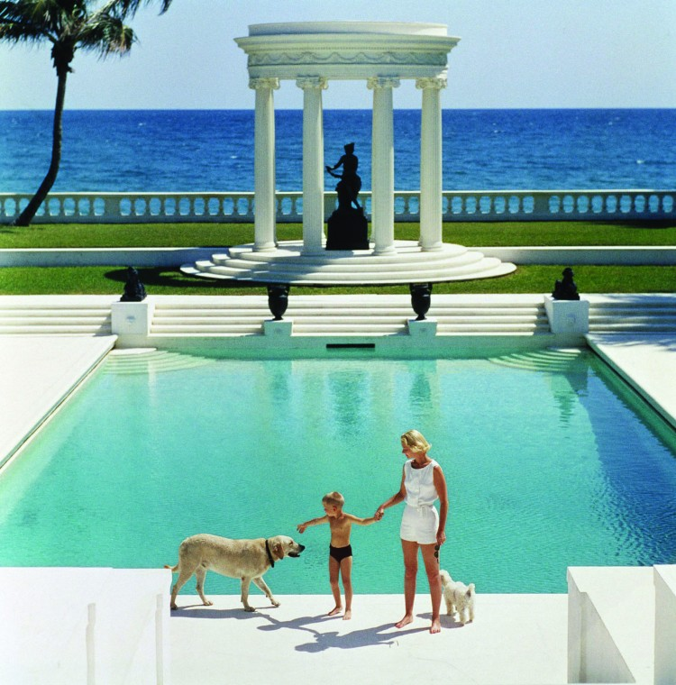 "Slim Aarons ""The Good Life, 1955: C.Z. Guest and her son Alexander and dog at the pool at their home Villa Artemis in Palm Beach"""